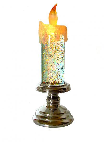 A gyertya belső világítását felkapcsolva a folyadékban lebegő csillám-szemcsék ragyogása fokozódik
